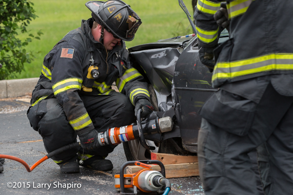 fire department demonstration of cutting apart a car