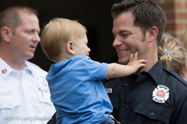 fireman with his toddler son
