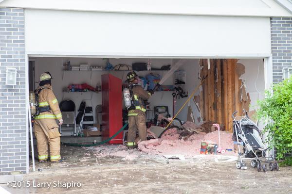 fireman overhauls garage after fire