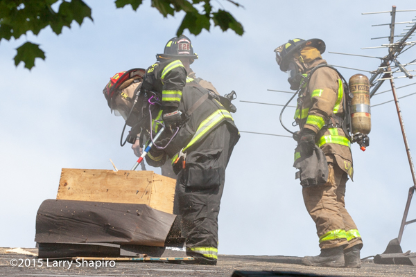 firemen cut vent hole in roof