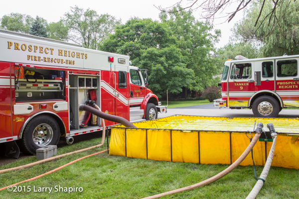 fire engine drafting water from portable tank