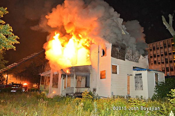 house full engulfed in fire at night