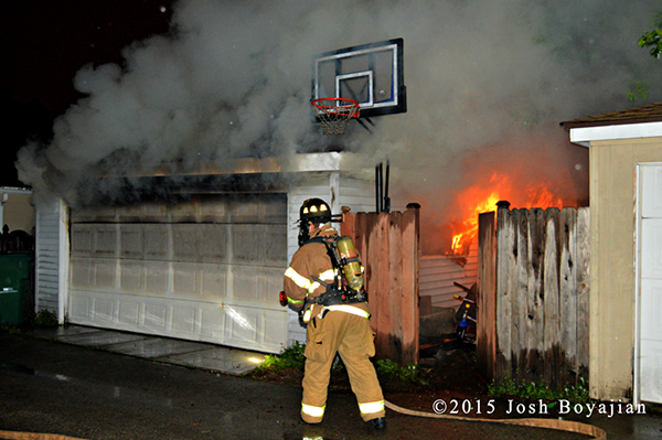alley garage on fire at night in Berwyn IL
