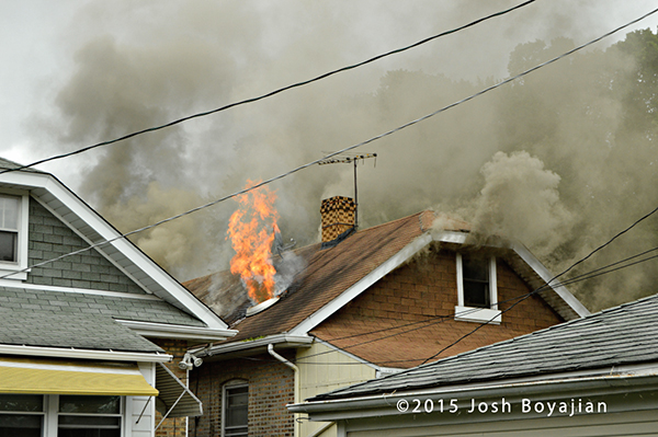 flames from the attic of a house