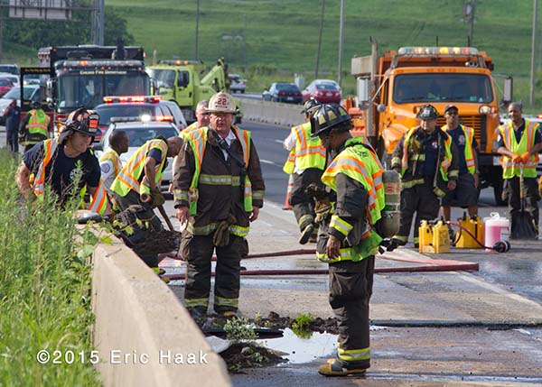 firefighters at haz mat scene on highway