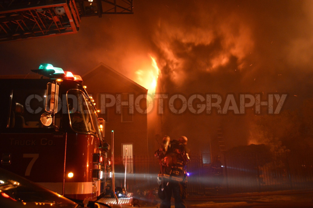 billowing flames from house fire at night