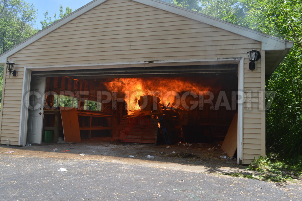 vacant garage filled with fire