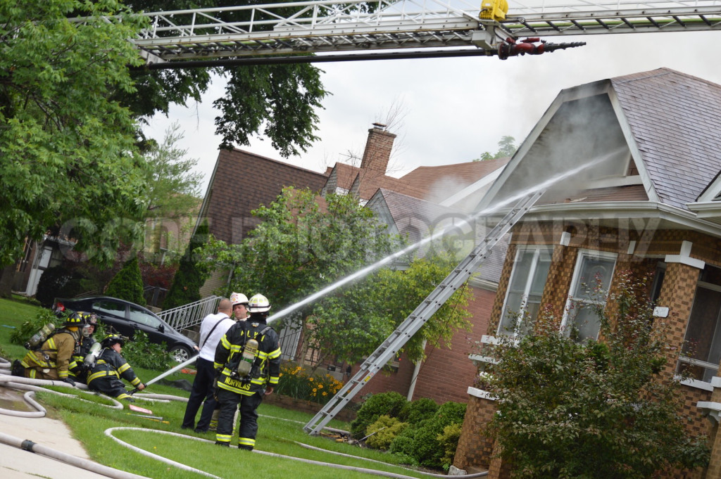 firemen fight house fire