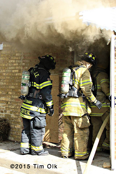 firemen enter house with smoke