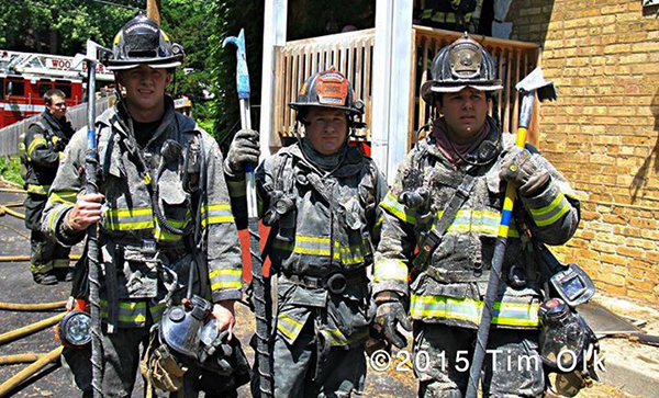 firemen pose after overhaul