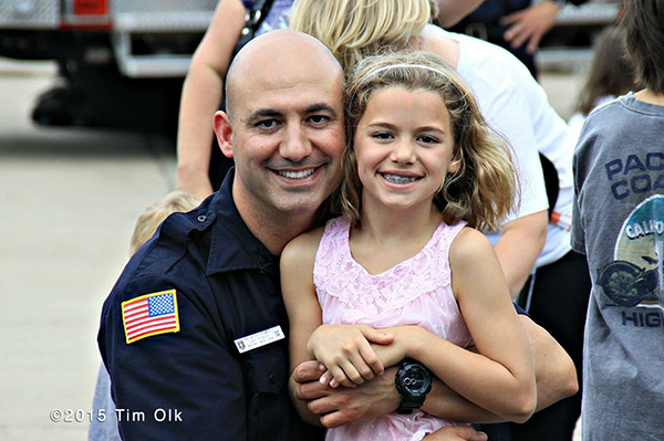 fireman with his daughter