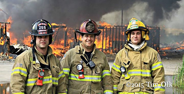firemen posing at burn down