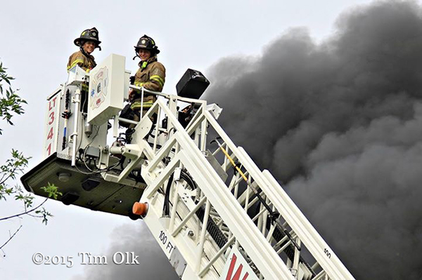 tower ladder basket against black smoke