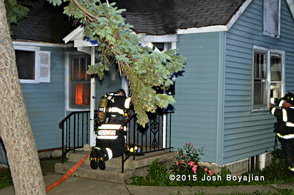 fireman masks up to enter a house