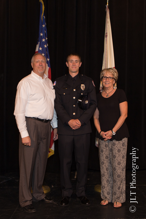 newly promoted fireman with family
