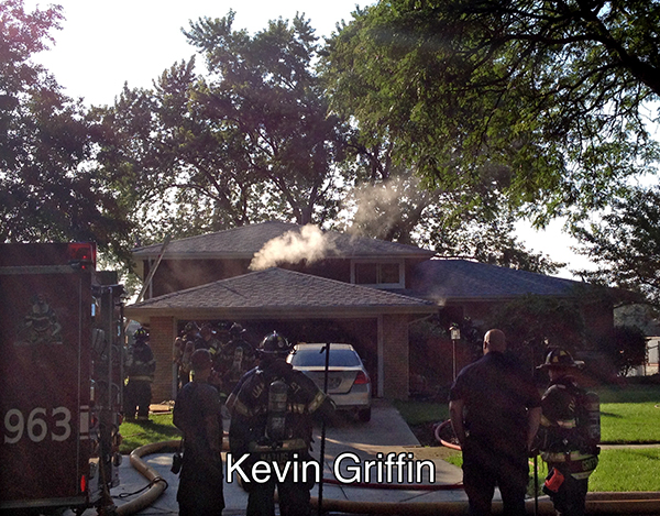 firemen on the scene of a small garage fire