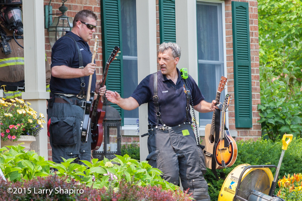 firemen retrieve musical instruments from house after fire