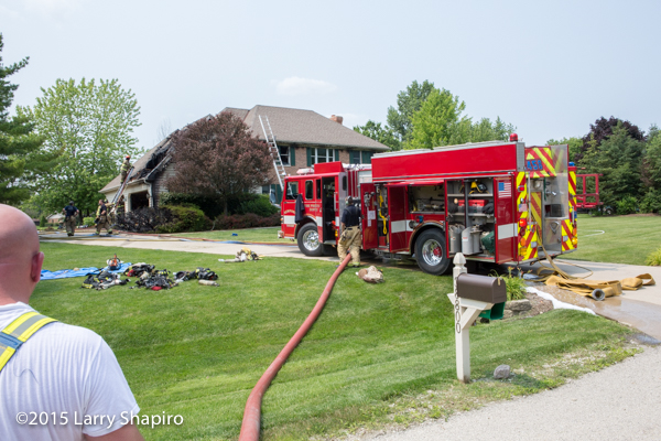 fire engine in driveway at house fire scene