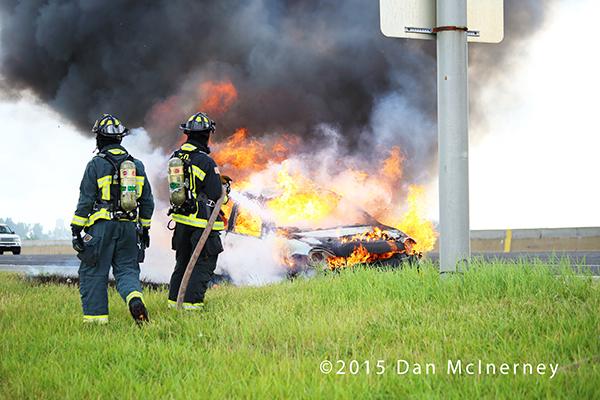 firemen extinguish a car fire
