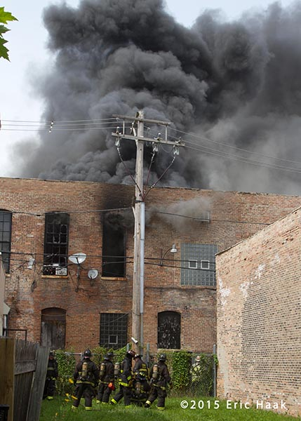 heavy black smoke from commercial building on fire