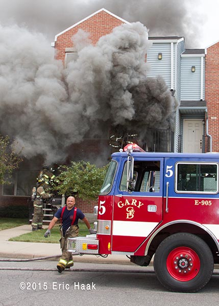 heavy smoke from apartment with fire engine