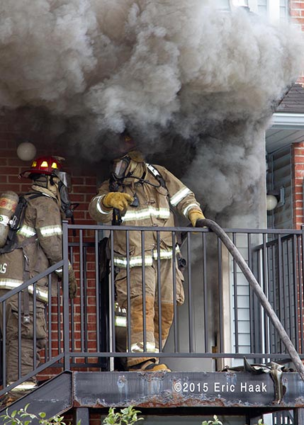 firemen at front door emerged in heavy smoke