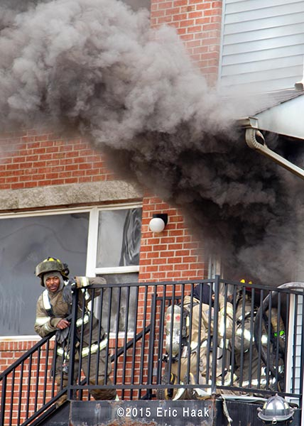 firemen enter apartment building with heavy smoke