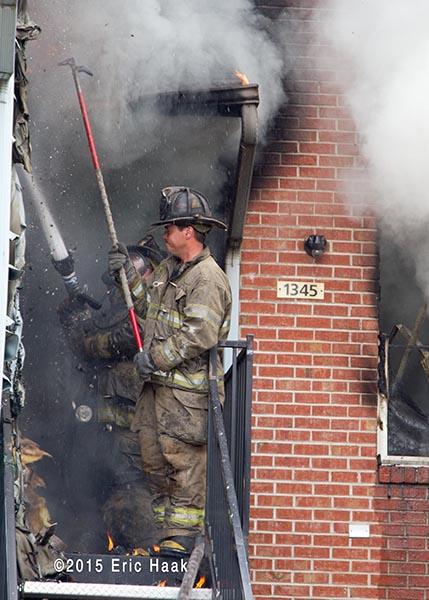 firemen in doorway with heavy smoke