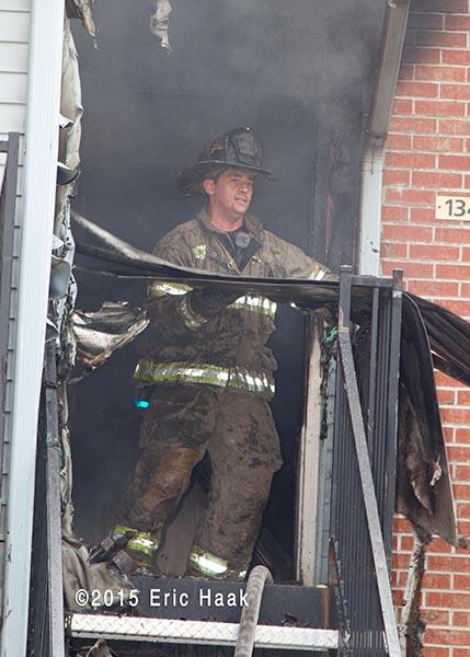 fireman performs overhaul