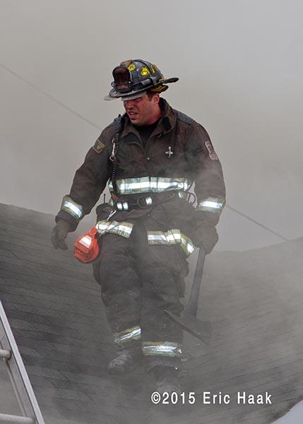 fireman o roof with smoke