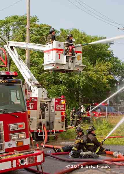 fire trucks working at fire scene