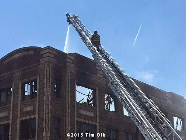 fire department aerial ladder at ruins of huge fire