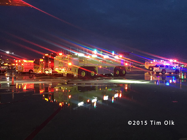 night photo of airport fire trucks