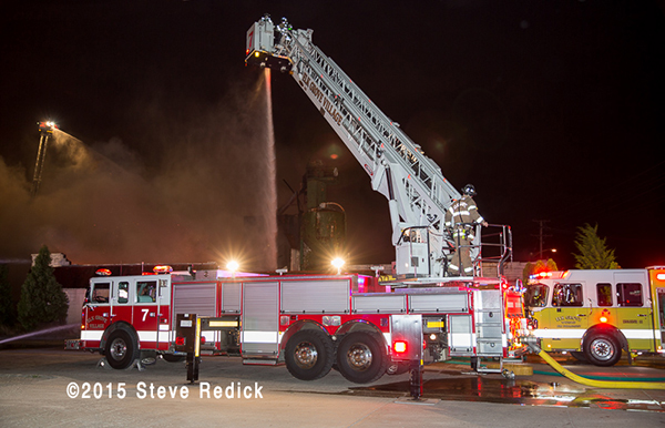night fire scene with fire trucks