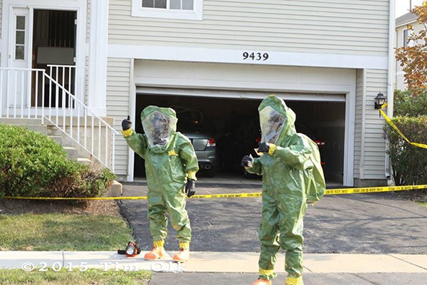 firefighters in haz mat suits