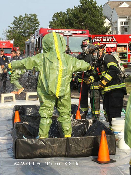 firefighters in haz mat suits in decon