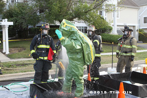hazardous materials crew in decon at haz mat scene