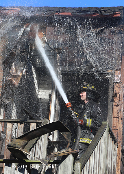 fireman overhauls after fire
