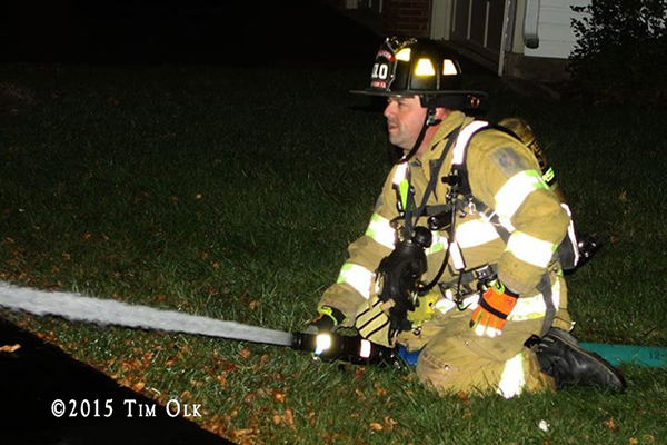 fireman with hose at fire scene
