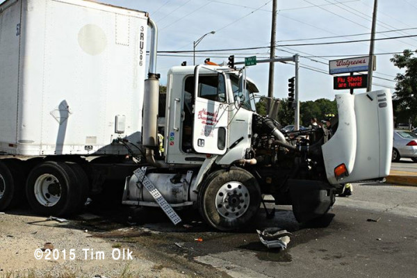 crash with two semi trucks