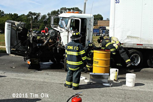 firemen monitor diesel spill at truck crash