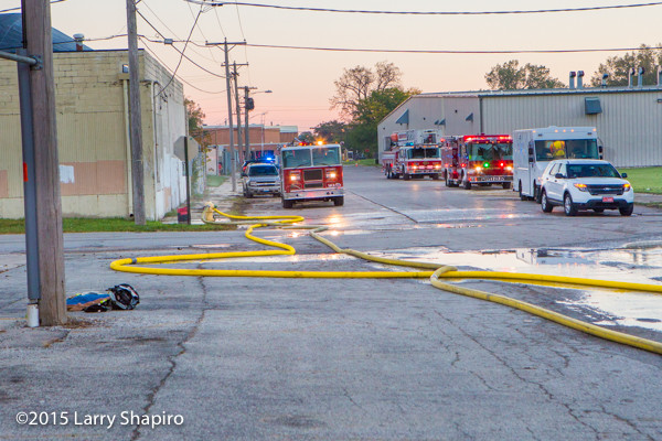 large diameter LDH hose on the ground at a fire scene