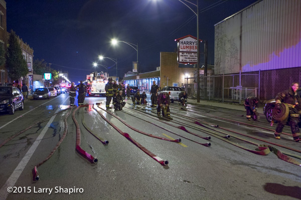 firemen roll hose after a fire