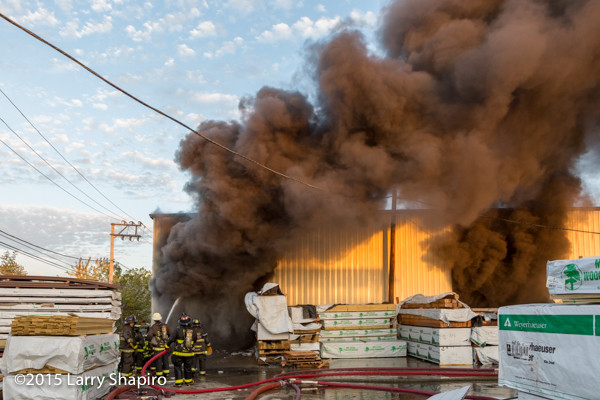 heavy black smoke at lumberyard fire