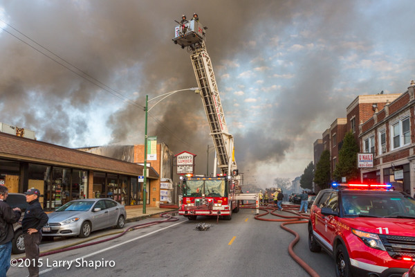 Chicago FD tower ladder working at a fire scene