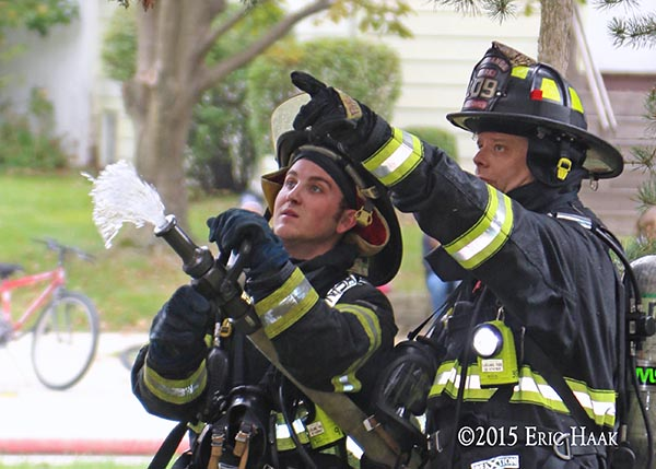 female firefighter receives instruction from an instructor
