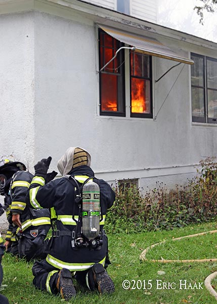 firefighters burn a house for training