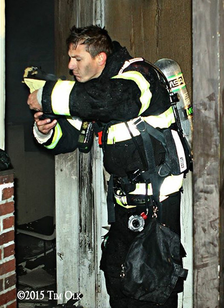 fireman at night fire scene