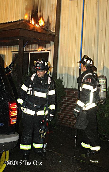 firemen at night fire scene