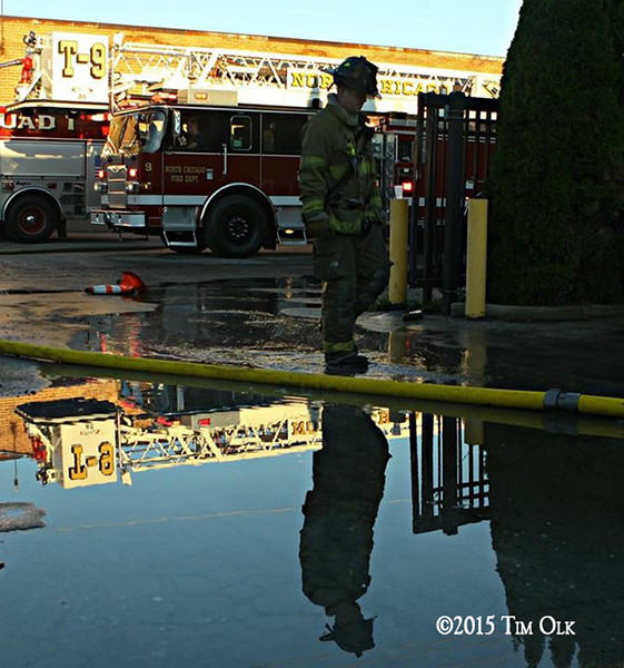 reflection of fireman at fire scene